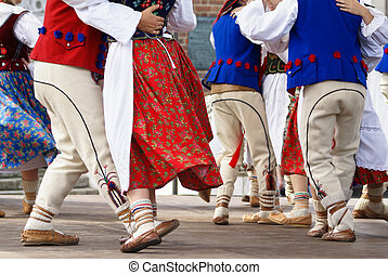 Horizontal colour image of female polish dancers in...
