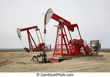 Duel pumpjacks on a shared lease. Alberta, Canada