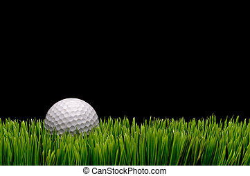 Horizontal image of a white golf ball in green grass on a...