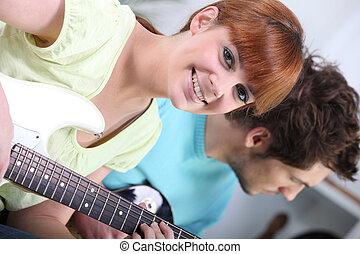 Horizontal image of girl with guitar