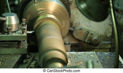 Horizontal milling machine processes swirling metal blank with coolant dripping.