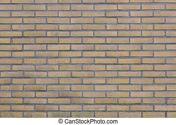 part of brick wall with yellow bricks