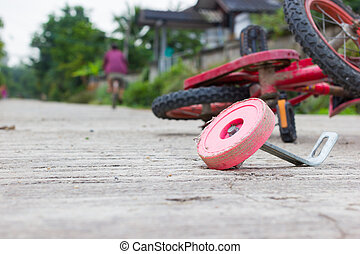 horizontal photo of closeup bicycle for children accident on the city street