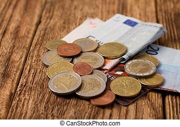 Coins, bills and credit card on one heap