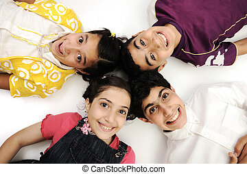 Horizontal  photo of four children group,  friends smiling isolated on white, boys and girls closeup