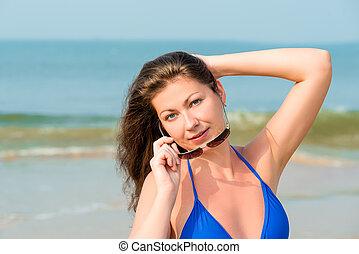 Horizontal portrait of a beautiful girl on the beach