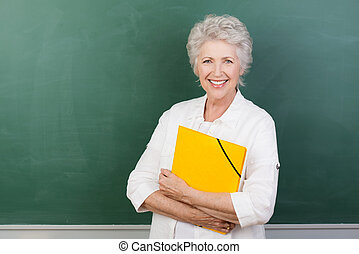Caucasian cheerful female senior teacher