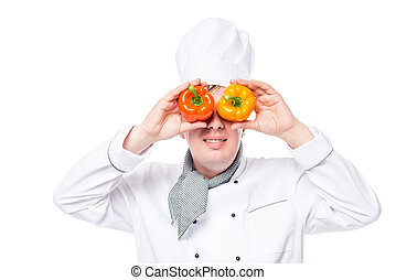 Horizontal portrait of a cook with binoculars pepper on a white background