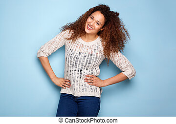 portrait of young woman smiling against blue background