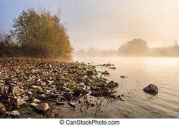 horizontal river pebble beach in Foggy morning - Foggy...