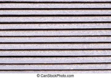 horizontal stripes of metal jalousie exterior. background, texture.