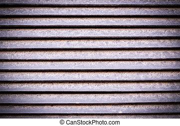 horizontal stripes of metal jalousie exterior with vignette. background, texture.