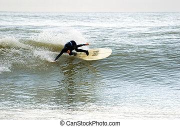 Horizontal surf pose - Surfing the break at Haumoana Beach, ...