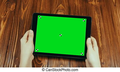 Horizontal Tablet With Green Screen In Hands
