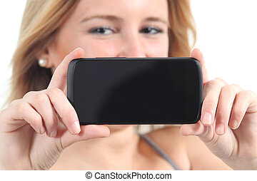 Horizontal view of a woman showing a black smartphone screen