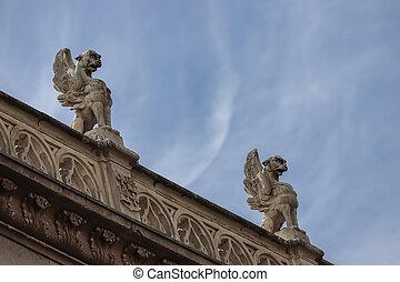 gargoyles on the facade of the archiepiscopal palace of alcala de henares