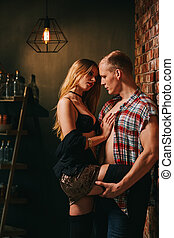 Horny woman seducing handsome man