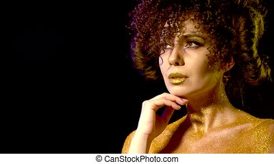 Horoscope woman with golden powder cosmetics on bare...