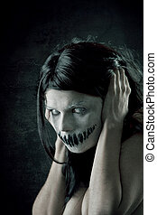 Horrible girl with scary mouth and eyes, extreme body-art