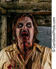 Horrible hungry zombie - Photo of a hungry zombie covered...