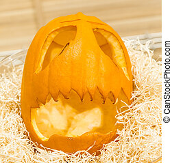 horrible the head of a pumpkin on Halloween holiday