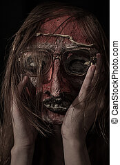 Horrible theatrical mask dressed In Glasses