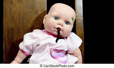 Horror clip toy baby vomits blood