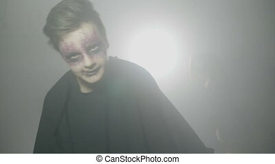 Horror halloween party with people wearing scary costumes...