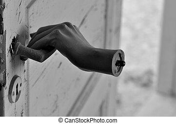horror hand - Detached doll hand pulling old door handle in ...