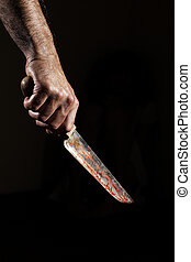 Horror - Man with bloody knife, hand close up, dark ...
