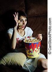 Horror movie - An image of woman watching TV with popcorn