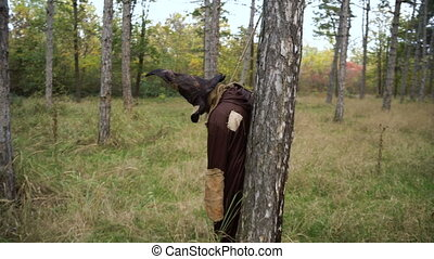 Horror Scarecrow standing in the forest with Sackcloth Mask...