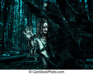 Horror undead woman looks out from behind a tree. - Zombie...