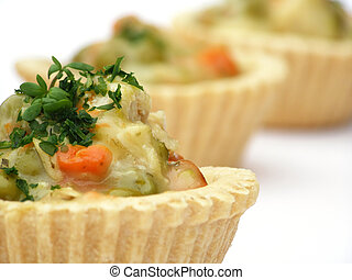 hors d'oeuvre - Close-up of tartlet filled with carrot, peas...