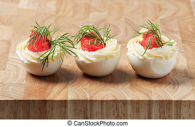 Egg whites filled with creamy spread and caviar