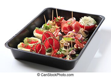 Variety of hors d'oeuvres on a baking tray