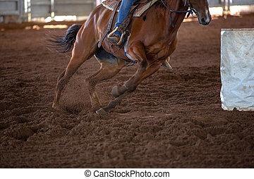 Horse And Rider Barrel Racing At A Rodeo