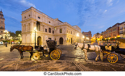 Horse carriages near ayuntamiento in morning. Seville