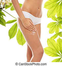 Horse chestnut body cream - Woman legs with moisturizer...