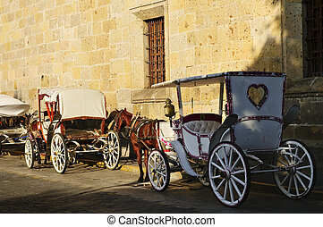 Horse drawn carriages in Guadalajara, Jalisco, Mexico -...