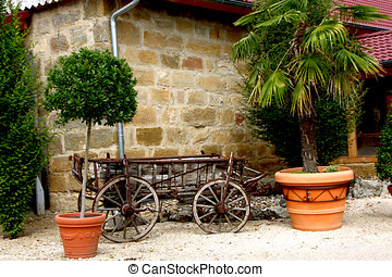 horse-drawn - An old horse-drawn carriage in front of a wall...