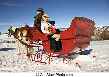 Horse-drawn sleigh ride. - Young adult Caucasian woman...