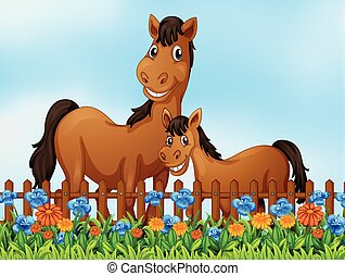 Horse family at flower garden