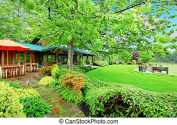 Horse farm house back yard with covered deck