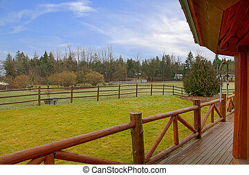 Horse farm land and house porch