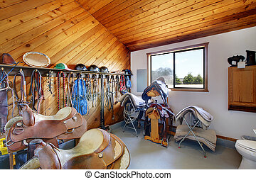Horse farm room with riding saddles and equipment - Horse ...