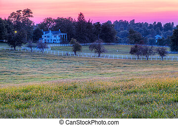 Horse Farm Sunset - Sunset behind the rolling hills on a...
