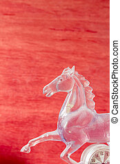 Horse of glass on background.