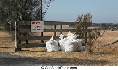 Horse Poo - Horse poo for sale at a fence in Australia