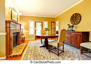Horse ranch dining room with fireplace and wooden cabinet.